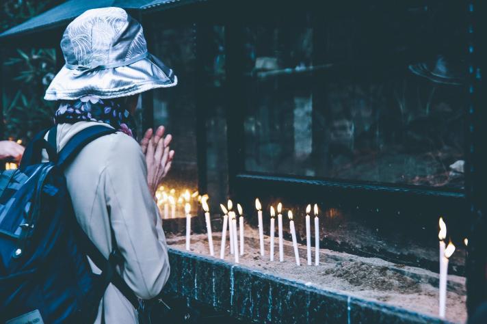 Praying, thankful.